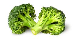 Two broccoli florets beside - stock photo