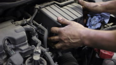 Changing of air filter at the car  service station Stock Footage