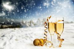 Christmas decorations and champagne against winter background - stock photo