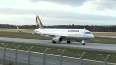 Lufthansa Airbus taxiing on runway Stock Footage