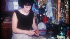 2830 - housewife prepares a dish for the family dinner - vintage film home movie - stock footage