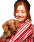 Young woman with a dachshund - stock photo