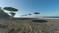 Sun umbrellas at greece beach Stock Footage