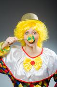 Stock Photo of Clown in funny concept on dark background