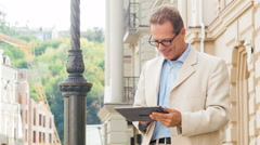 Businessman on the street using tablet Stock Footage