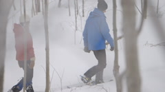 Slow motion shot of snowshoeing in Grey County with colour contrast in the snow. Stock Footage