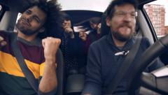 Four cool people dancing like crazy driving car happy Stock Footage