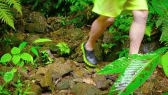 Tourist Negotiating a Rough Trail over Slippery Rocks in the Rain. Stock Footage