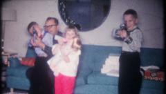 2831 - boys get toy machine guns for Christmas - vintage film home movie Stock Footage