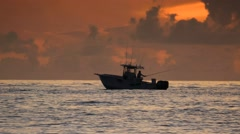 Deep Sea Ocean Saltwater Fishing on Boat During Florida Sunrise Stock Footage