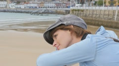 Young woman with hat admiring scenery over bridge - stock footage