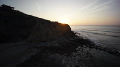 Sunset with ocean cliffs and house Stock Footage