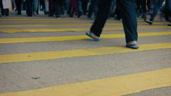 Legs and Feet of  Pedestrians Crossing a Busy Urban Street Stock Footage