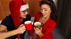 Young couple drinking hot drinks. Christmas time. 50 fps. Stock Footage