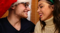 Young couple trying on Christmas outfits. Christmas time. 50 fps. Stock Footage