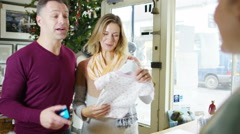 4K Happy couple expecting a baby buying baby clothes in shop Stock Footage