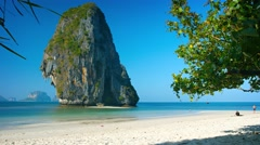 Massive Limestone Formation Towers over Tropical Beach Paradise. Thailand Stock Footage