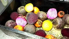 Closing up on a purple beetroot, between candy stripe and golden beetroot hal Stock Footage