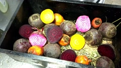 Closeup on a purple beetroot, between candy stripe and golden beetroot halves - stock footage