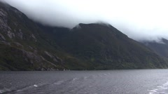Milford Sound Fjords Cruising Overcast - stock footage