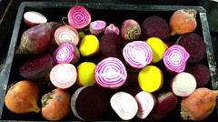 Closeup on a candy stripe beetroot, between purple and golden beetroot halves - stock footage