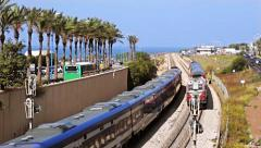 Two trains on the railway with sea on the background - stock footage