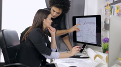 Two interior designers at work in studio Stock Footage