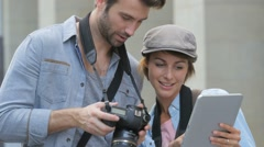 Team of photographers checking shots on digital tablet - stock footage