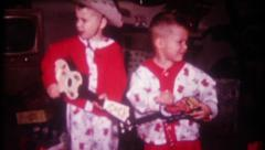 2834 - boys get toy guitars for Christmas - vintage film home movie Stock Footage