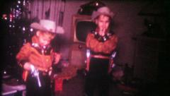 2833 - boys get cowboy outfits & pistols for Christmas - vintage film home movie Stock Footage