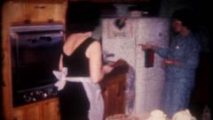 2835 - women prepare for holiday dinner at home - vintage film home movie Stock Footage