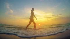 Seashore sunset walk silhouette model girl 4k Stock Footage