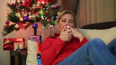 Portrait of a woman sitting near the christmas tree  21 Stock Footage