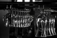 Cocktail glasses in rack - stock photo