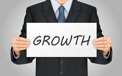 Stock Illustration of businessman holding growth poster