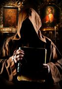 Portrait of medieval monk with bible in church Stock Photos