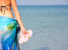 Woman with flip flops Stock Photos