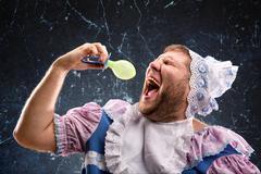 Crazy man sucking a pacifier Stock Photos