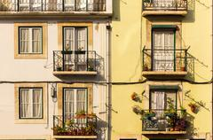 Building wall with windows and balconies - stock photo