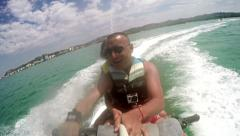 Jet ski fun recreation of young couple enjoying summer time. Stock Footage