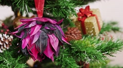 Decoration of Christmas tree purple flower toy - stock footage