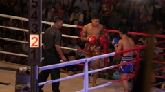 Thai boxing, boy gets hit bad,Ubon Ratchathani,Thailand Stock Footage