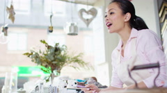 4K Cheerful business owner taking payment from customers in her shop - stock footage