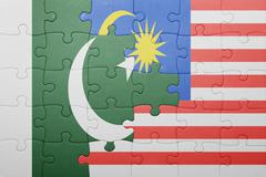 puzzle with the national flag of malaysia and pakistan - stock photo