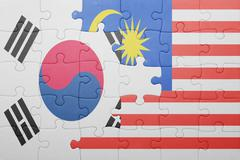 puzzle with the national flag of malaysia and south korea - stock photo