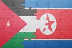 puzzle with the national flag of north korea and jordan - stock photo