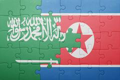 puzzle with the national flag of north korea and saudi arabia - stock photo