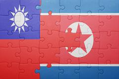 puzzle with the national flag of north korea and taiwan - stock photo