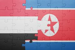 puzzle with the national flag of north korea and yemen - stock photo