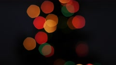 Colorful lights bokeh on black background. Pan - stock footage